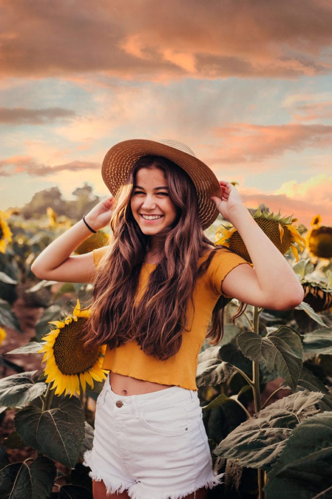 London Family Photographer, girl wearing a hat in a sunflower field